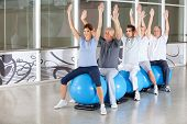 Gymnastics class for happy seniors on gym balls in fitness center