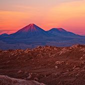 sunset over volcanoes Licancabur and Juriques, Chile