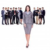successful business team with a business woman walking forward leading it - be different concept - i