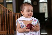 picture of salwar  - cute south asian baby in traditional clothes holding an apple - JPG