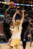 LOS ANGELES - MARCH 12: Arizona Wildcats C Kyryl Natyazhko #1 (C) Washington Huskies F Darnell Gant