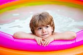 Little Girl Having Fun In Swimming-pool. Happy Child Having Fun At Swimming Pool On Sunny Day. Child poster