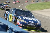 FONTANA, CA. - OCT 10: Sprint Cup Series driver Jimmie Johnson in the Lowe's #48 car leads the pack