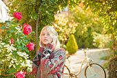 Girl Listen Music And Ride Bicycle. Blonde Enjoy Music In Park Or Garden. Active Girl With Headphone poster