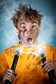 image of teen smoking  - Electric shock sees a shocked boy - JPG