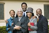 stock photo of ecclesiastical clothing  - Smiling Family with Preacher - JPG