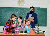 Happy Children Teacher. Back To School. Kids In Lab Coat Learning Chemistry In School Laboratory. Do poster