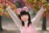 japanese lolita fashion in park during fall season, Tokyo