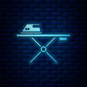 Glowing Neon Electric Iron And Ironing Board Icon Isolated On Brick Wall Background. Steam Iron. Vec poster