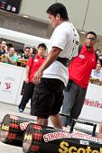 TOA PAYOH, SINGAPORE - MARCH 24 : Contender for Strongman  Mohd Asri Abd Kadir attempts the 2 times