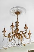 picture of light fixture  - beautiful bronze chandelier in a modern apartment - JPG