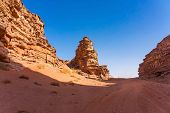 Red Mountains Of Wadi Rum Desert In Jordan. Wadi Rum Also Known As The Valley Of The Moon Is A Valle poster