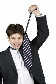 businessman screaming and pulling his tie