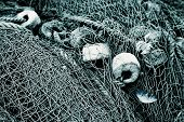 Fishing nets closeup with a fish catch