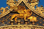 The Venetian lion on a cathedral building on San Marco square. Venice. Italy.