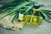 Cannabis Oil On Bottle Products Wooden Background - Cbd Oil Extract From Cannabis Leaf Marijuana Lea poster