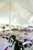 picture of tent  - Inside a large wedding tent set up for an outdoor reception - JPG