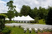 stock photo of lawn chair  - Wedding tent set up for an outdoor wedding or other event - JPG
