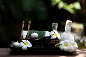 Thai Spa Composition Treatments Aroma Therapy With Candles And Plumeria Flowers On Wooden Table Clos poster