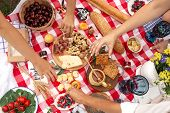 Top View People Take Food From Checkered Picnic Blanket. Outdoor Summer Family Picnic. poster