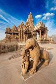 King and lion fight statue and Kandariya Mahadev temple.  Khajuraho, India