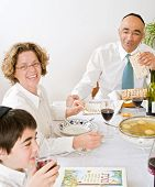 picture of seder  - father mother and son in seder celebrating passover - JPG