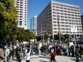 Protesters Hold Signs And Rally Behind Sfpd Fence Along 3Rd Street As Cops Gaurd The Street