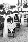 Wedding chairs with heart decoration, black and white