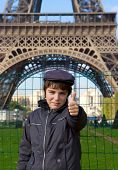 Happy teenager kid on front of Eiffel Tower, Paris