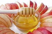 Cut Into Slices Of Apples With A Bowl Of Honey Closeup