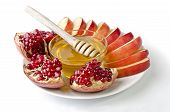 Cut Into Slices Of Apples, Pomegranate And Bowl Of Honey