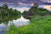 Spring Landscape At Sunset With Watermill And River