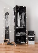 Clothes Organizer And Mirror Decorated With Lights