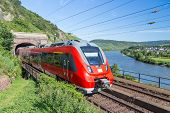 picture of moselle  - Intercity Train Leaving A Tunnel Near The River Moselle In Germany - JPG