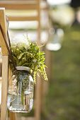 detail from wedding of bouquet in mason jar.