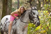 image of bareback  - woman in pink dress in forest on horse - JPG