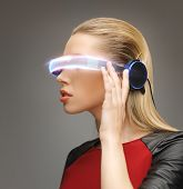 picture of beautiful woman with futuristic glasses