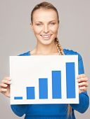 bright picture of confident woman with growth graph on board
