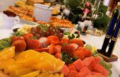 Fruit Tray of oranges grapes and strawberries on christmas theme table