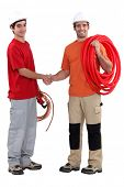 craftsman and apprentice shaking hands