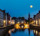 European medieval night city view background - Bruges (Brugge) canal in the evening, Belgium