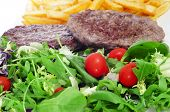 closeup of a combo platter with salad, burger and french fries
