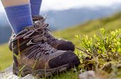 stock photo of tramp  - two tramping boots before a mountain landscape - JPG