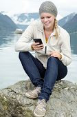 Young Blond Woman With Her Smartphone In The Hand