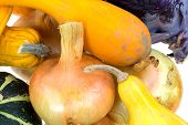 Close View Of Onions, Gourds And Red Cabbage