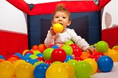 Baby Playing With Colorful Balls