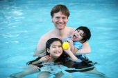 Father And Children In Pool