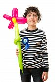 Child Holding a Flower Balloon During his Birthday Party. Over White Background. Boy  Smiling
