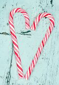 Candy Cane Heart On A Wooden Background