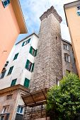 stock photo of genova  - The residential houses were attached to the medieval tower that was part of the defensive rampart Genova Italy.
